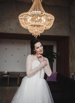 Elegant brunette bride in luxury white dress posing . bride portrait wedding makeup and hairstyle