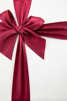 Elegant burgundy ribbon on white background