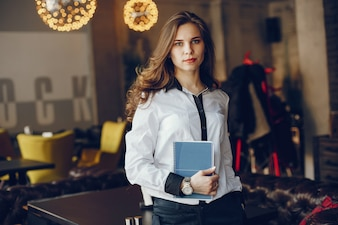 Elegant business girl with notebook