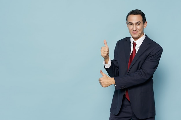 Elegant businessman in suit with thumbs up