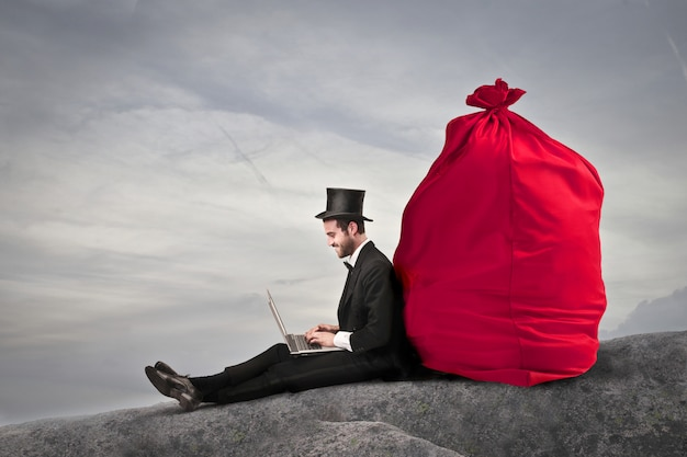 Elegant businessman with a bag of money