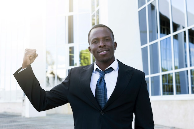 Elegant businessman with victory pose