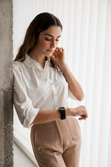 Elegant businesswoman looking at her smartwatch