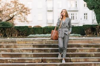 Elegant businesswoman making phone call in city