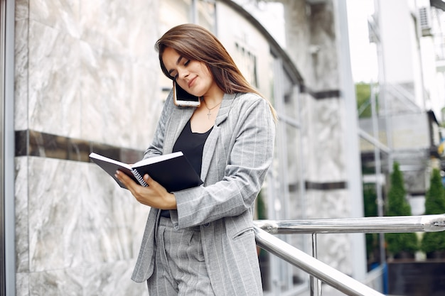 Elegant businesswoman working in a city and use the notebook