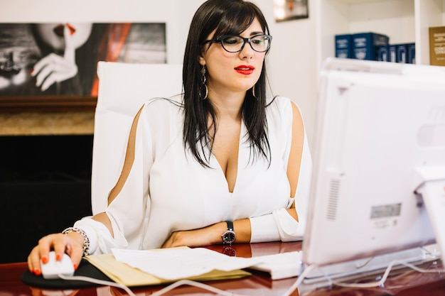 Elegant businesswoman working with computer