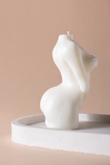 An elegant candle in the shape of a female body.
