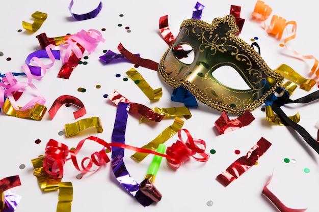 Elegant carnival mask on confetti