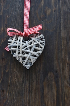 Elegant christmas heart on a wooden background