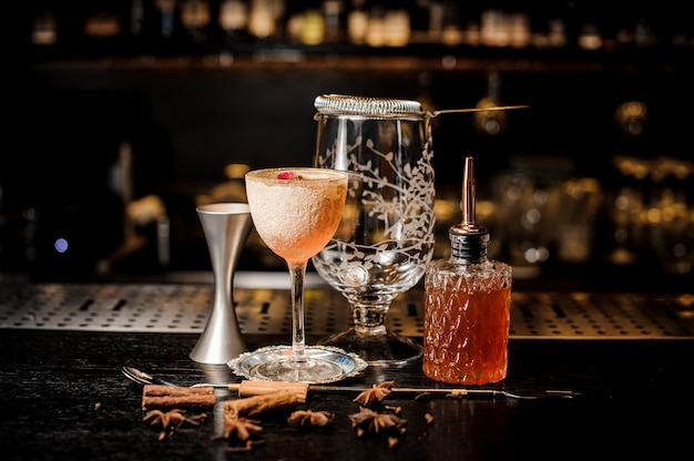 Elegant cocktail glass with tasty and sweet summer cocktail decorated with flower and powder