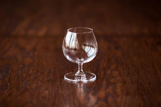 Elegant cognac glass on the dark wooden table