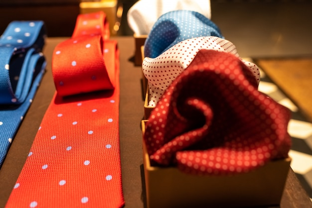 Elegant and colorful neckties and scarves exposed in a showcase.