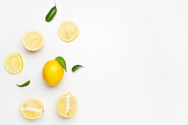 Elegant composition of set of lemons on a white surface