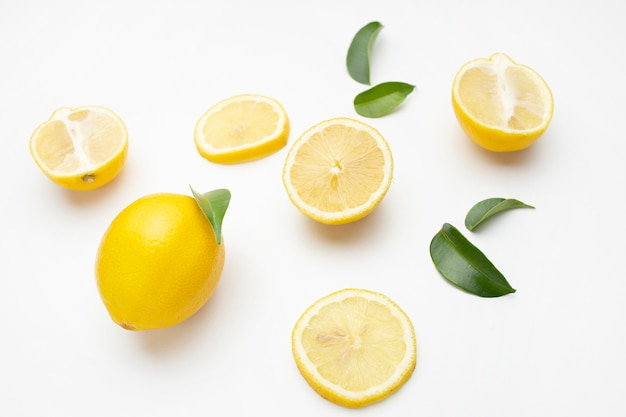 Elegant composition of set of lemons on a white surface