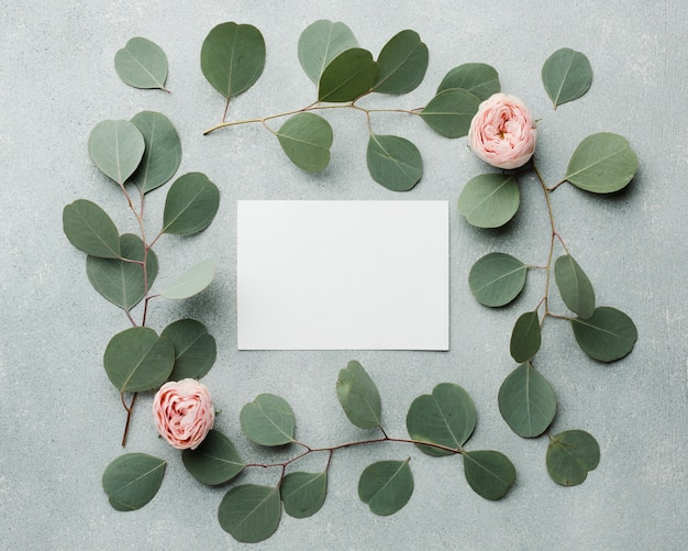 Elegant concept leaves and roses frame with empty card