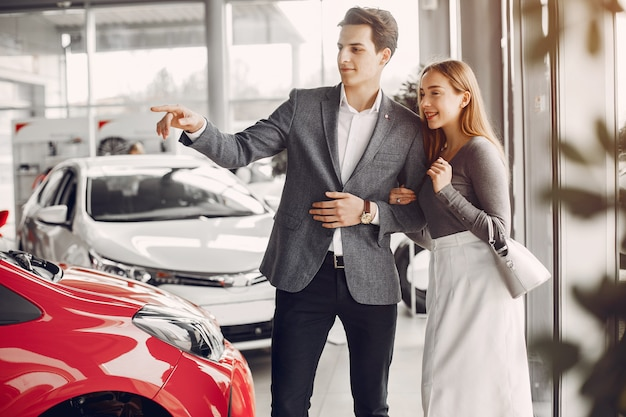 Elegant couple in a car salon