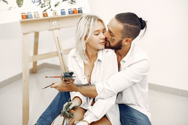 Elegant couple draws in an art studio