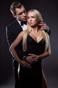 Elegant couple in love in evening dresses
