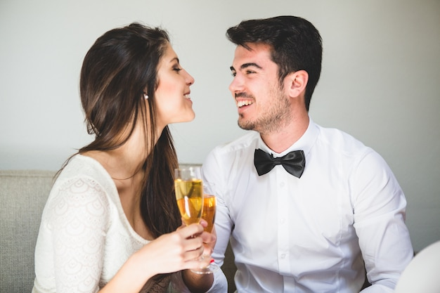 Elegant couple toasting and smiling to each other's face