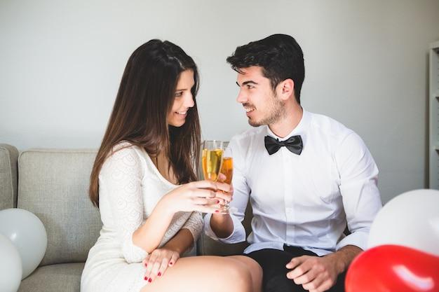 Elegant couple toasting with champelegant couple toasting with champagne glassesagne glasses