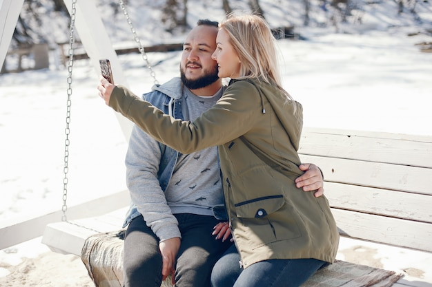Elegant couple in a winter park