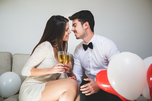 Elegant couple with champagne glasses Free Photo