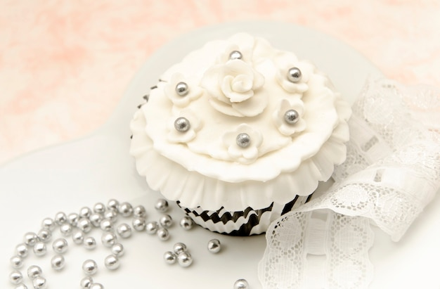 Elegant cupcakes with vintage decoration