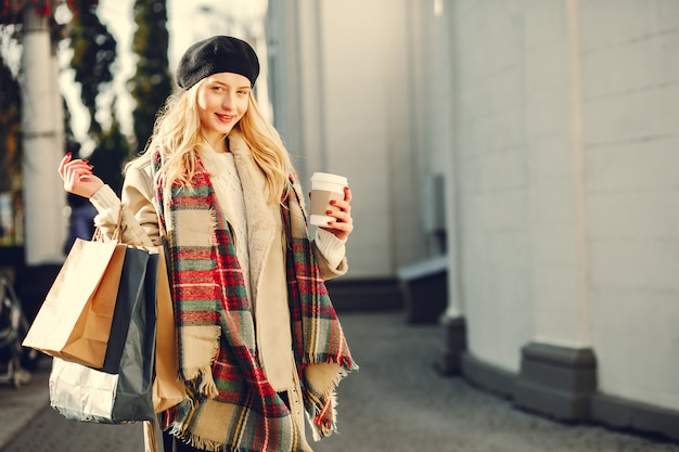 Elegant cute blonde walking in a city