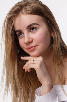 Elegant cute happy smiling teen model wearing shirt isolated on white background