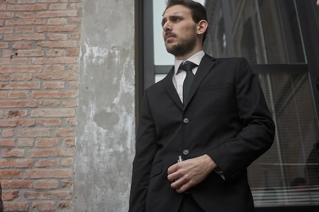 Elegant dress businessman between rustic palaces outdoor
