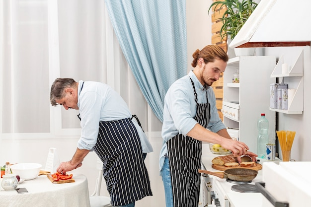 Elegant father and son cooking