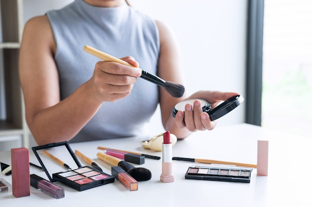 Elegant female beauty blogger showing testing beauty cosmetic using product makeup tutorial cosmetics and sale product