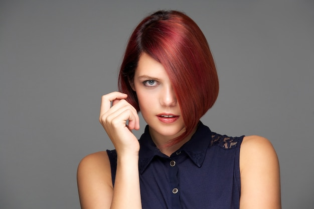 Elegant female fashion model with short red hair