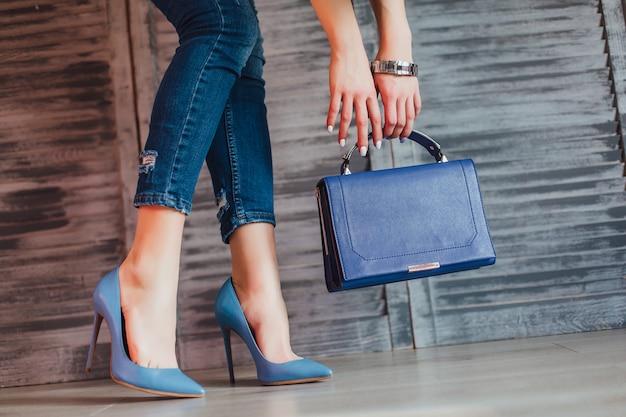 Elegant female legs in turguoise shoes.