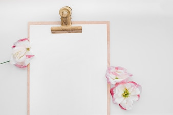 Elegant flowers and clipboard