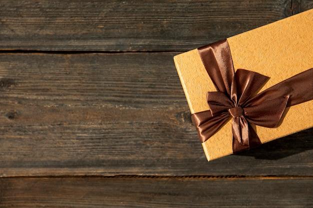 Elegant gift on wooden background