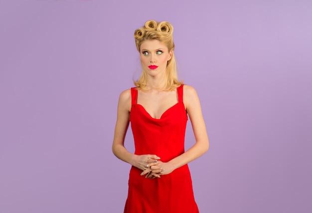 Elegant girl with beautiful hairdo perfect makeup fashionable pinup girl in elegant red dress