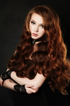 Elegant girl with red curly hair