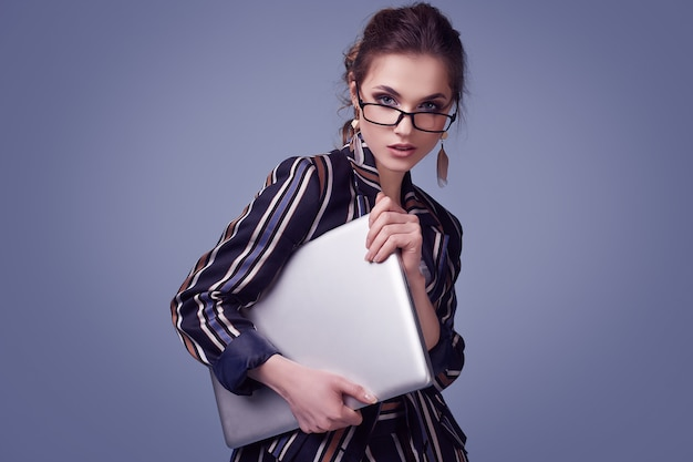 Elegant glamor woman in fashion suit and glasses with notebook