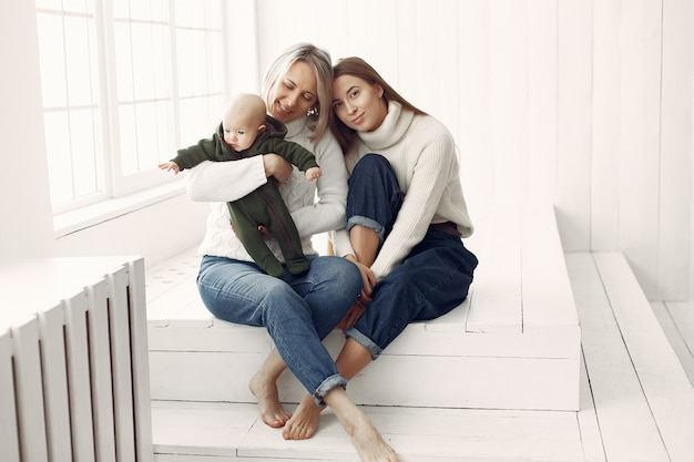 Elegant grandma at home with daughter and granddaughter