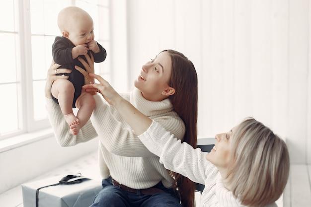 Elegant grandma at home with daughter and granddaughter