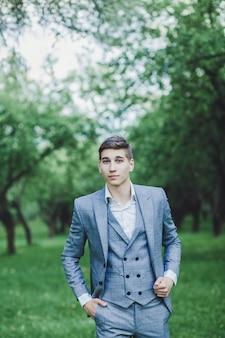 Elegant groom in costume