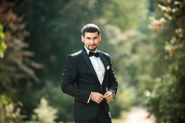 Elegant groom posing outdoors
