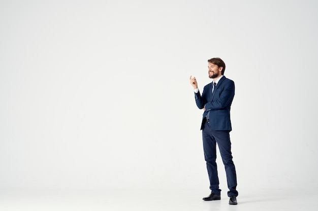 Elegant guy in a classic suit and gesturing with his hands business finance