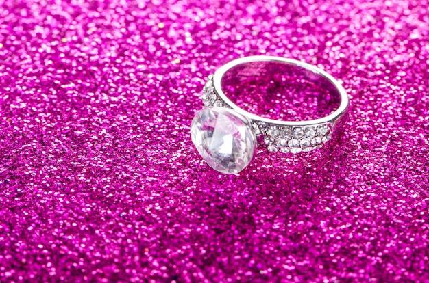 Elegant jewellery on shiny background
