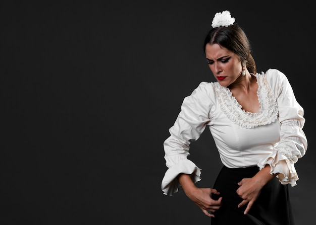 Elegant lady in flamenco dress performing