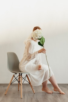 Elegant lady holding flower