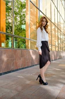 Elegant lady walking alone in the street