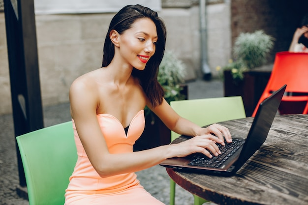 Elegant lady with laptop