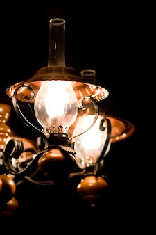 Elegant lamp on black background